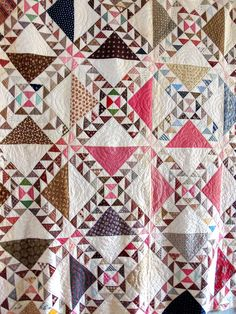 "Antique Handmade Wild GOOSE Chase Quilt Pinwheel Illusion Quilt | eBay seller I_spy_design; late 1800s/early 1900s; 82"" square, 16 blocks, each block 22"" square, medium weight cotton batting, slight bunching but for the most part evenly distributed, small cotton print on back, hand stitched & quilted; 1/3"" binding brought from the back."