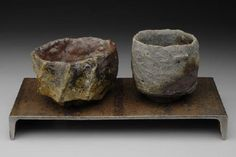 TIM ROWAN  Tea Bowl Pair, Raw with Natural Ash, 2008     Stoneware   $1750  Wood-fired native clay with metal stand