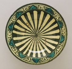 Bowl Egypt or Syria Bowl, 14th century Ceramic; Vessel, Fritware, underglaze-painted, Diameter: 10 3/4 in. (27.3 cm) The Madina Collection of Islamic Art, gift of Camilla Chandler Frost (M.2002.1.5) Art of the Middle East: Islamic Department.