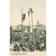 Yokohama, early 1900's.  Firefighters in happi coats perform acrobatic stunts on top of bamboo ladders. The ladder stunts were the main event of Japanese New Year celebrations. The demonstrations, called dezome-shiki, were intended to warn people of the dangers of fire, and to demonstrate the agility and courage of the firefighters.