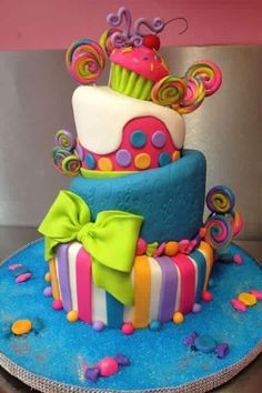 Wicked colourful cake with wonky tiers We've scoured the Web in search cool birthday cake designs and narrowed it down to the top ten birthday cake designs that we could find. Top 10 Birthday Cake Designs Awesome cake………I am going to tell my mom h Pretty Cakes, Cute Cakes, Candy Cakes, Cupcake Cakes, Candy Theme Cake, Bolo Artificial, Bolo Original, Bolo Fack, 10 Birthday Cake