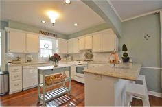 50s kitchen - redone - wood floor, white cabinets & white appliances (which don't look bad)