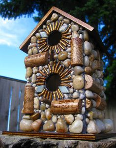 Outdoor Wine Cork Birdhouse with gold accents. $105.00, via Etsy.
