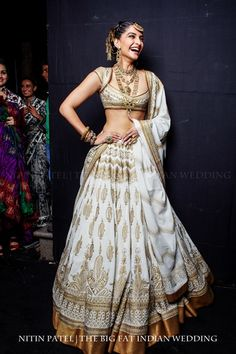 Sonam Kapoor looking gorgeous in a white and gold Indian lengha by Rohit Bal | India Bridal Fashion Week 2013. Photo by Nitin Patel
