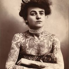 Maud Wagner, 1877 - 1961 Born in Lyon County Kansas, Maud Wagner was the first known female tattoo artist in the United States. Originally a skilled aerial acrobat and contortionist in numerous travelling circuses, Maud met her future husband Gus Wagner at the Louisiana Purchase Exposition in 1904. She traded a date with her for tattoo lessons and the two eventually married. Their daughter, Lotteva, started tattooing at nine years old and later became a tattoo artist herself. Despite the…