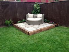 Small garden patio using wooden sleepers. Perfect sun spot.