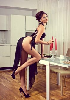 Gorgeous model with stunning legs in a slinky gown and towering high heels.