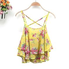 Casual women's flower camie chiffon tank top,in a loose fit chiffon fabric with cross over back strap.irregularity border,style with skinny jeans and heels for a totally babin look. Size: Bust: 90cm (