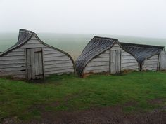 boat sheds made from upside down herring boats near the lindesfarne castle, scotland photo credit; tim parkinson