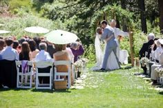 ceremony wildflower arch Rustic Mountain wedding Located in the Village Lodge at Sugar Bowl Resort California