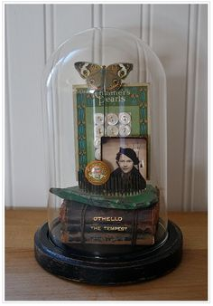 Another great looking vignette under a glass cloche.
