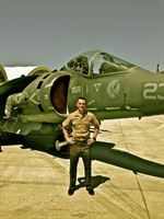 Capt. Nicholas Dimitruk stands in front of an AV-8B Harrier on the flightline at MCAS Yuma. Dimitruk is a forward air controller with Battal...