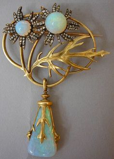 Lalique 1898 brooch - opals, gold & diamonds. Love the use of gold used on this piece.