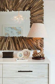 Large drift wood mirror adding a rustic beach vibe