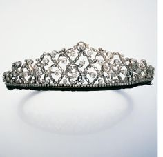 A late Victorian diamond tiara, circa 1880, the row of collet-set old brilliant-cut diamonds supporting a trellis of meandering foliate motifs with old brilliant-cut diamond bud detail, diamonds approximately 15.00 carats total, one diamond deficient, originally detachable from frame for probable conversion to a necklace, fittings now deficient