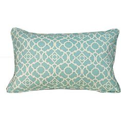 This blue pillow features a modern Moroccan print that goes well with the room decor