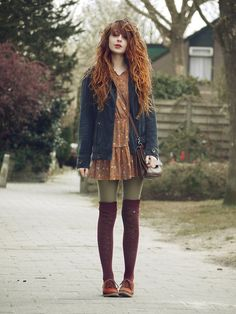 Gorgeous autumn colours, textured stockings, leather brogues... love everything about this outfit (and her amazing hair!)