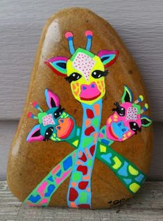 BIG Original Hand Painted BRIGHT GIRAFFE Paperweight by Seneca Rock Art on a stone rock by Seneca! Sealed with a glossy UV protectant sealer.These are the absolute most adorable painted rocks! If you love the painted rock trend you are going to love these Rock Painting Patterns, Rock Painting Ideas Easy, Rock Painting Designs, Paint Designs, Rock Painting Kids, Creative Painting Ideas, Painting Crafts For Kids, Painting Tutorials, Creative Ideas