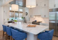 Calcutta Gold Extra countertops bring a sophisticated vibe to the all-white kitchen. Beach House Plans, All White Kitchen, Kitchen Stools, Kitchen Cabinets, Florida Vacation, Luxury Interior Design, House Tours, Luxury Homes, Kitchen Remodel