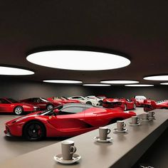 Ferrari collector personal garage is that awesome he can hold his own Cars & Coffee event any day of the week. Man Cave Garage, Garage House, Dream Garage, Car Garage, Garage Shop, Underground Garage, Cool Garages, Garage Interior, Showroom Design