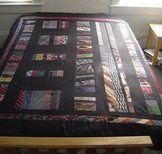 a gorgeous quilt made from neckties