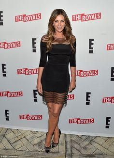 Simply stunning: Thge star's LBD clung to the Austin Powers star's toned and trim figure, accentuating her waist and flat tummy
