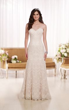 D1758 This Lace over Lavish Satin modified A-Line wedding dress features a scalloped Lace sweetheart neckline and hem. Exclusive wedding dresses from Essense of Australia. #weddingdresses