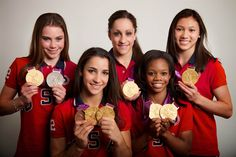 """The U.S. gymnastics team shows off their medals for a portrait during the 2012 Olympics in London on August 9. They are Kyla Ross, McKayla Maroney, Aly Raisman, Jordyn Wieber and Gabrielle Douglas. The """"fierce five"""" took home the U.S.'s second team gold medal."""