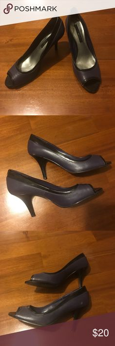 Purple Heels 👠 Cute purple heels with black trim and heel. Great for date night or work. Pre loved condition. A couple small scuffs as pictured but otherwise good condition. Heel is about 3 1/4 in. Bandolino Shoes Heels