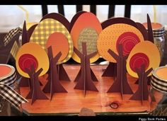 """Get crafty! Use craft paper and art supplies to create decorative fall trees for a """"Happy Harvest"""" themed Thanksgiving table. This option is great for kids' Thanksgiving tables. Keep the little ones busy with the art supplies so you can enjoy your turkey in peace!     Design + Photo by Piggy Bank Parties. Thanksgiving Centerpieces, Thanksgiving Crafts, Fall Crafts, Holiday Crafts, Holiday Ideas, Harvest Party, Fall Harvest, Harvest Crafts, Fall Dinner"""