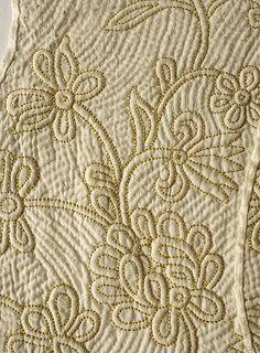 1720, Detail of an embroidered silk and linen stomacher. Metropolitan Museum of Art, New York, USA.