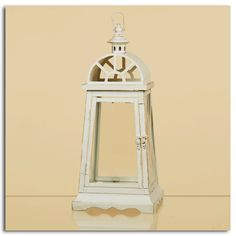 """7.5"""" x 17"""" Ivory Lantern Item #: 79513 Price: $38.00    The country chic styling and cream color of this metal lantern is a look that will capture the hearts of anyone who enjoys a comfortable look at home. Beautiful as a stand-alone accent and perfect when put to work with candlelight to add a romantic glow to an outdoor gathering."""
