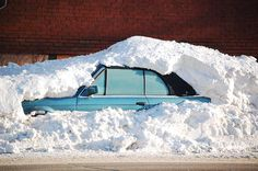 A car near downtown St. Paul is stuck under piles of snow on Tuesday, December 14, 2010 as the region continues to dig out.