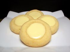 Cheesecake Thumbprint Cookies. Cream cheese, sugar, salt, eggs, sour cream, vanilla, unsalted butter, & flour.