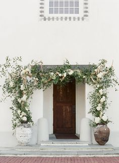 Rosemary Beach Wedding, Alys Beach wedding, Seaside wedding, flower entrance to Rosemary Town Hall, white hydrangea, white roses. Floral design by Nouveau.
