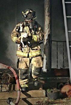 firefighter saving puppy