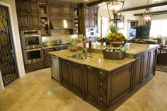 The massive two-tiered wood and granite kitchen island makes this kitchen stand out.