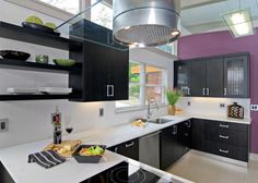 Purple Wall with Black Cabinets Contemporary Kitchen by In Detail Interiors