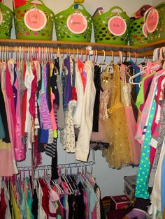 Organize Girls walk-in closet with baskets from dollar tree , add tags , ribbon and laminate ...http://organizethisfamily.blogspot.com/2013/03/organizing-girls-closet.html