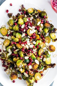 Looking for a side dish easy enough for a weeknight meal, yet fancy enough for entertaining guests? This Pomegranate Roasted Brussels Sprouts recipe is the seasonal side dish you need! Sweet and tart, this simple side dish will enhance any meal! Steak Side Dishes, Healthy Side Dishes, Side Dishes Easy, Side Dish Recipes, Sprout Recipes, Vegetable Recipes, Vegetarian Recipes, Healthy Recipes, Diet Recipes