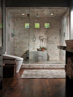 For many homeowners, it's out with the tub and in with the everyday luxury of a high-end shower. See how top HGTV.com designers decked out 8 steamy escapes.
