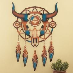 This uniquely designed dreamcatcher features a cattle skull in the center accented with Southwestern details and colors along with 5 feathers that hang below. Southwest Cattle Skull Dreamcatcher. Hooks on back make hanging easy. | eBay!