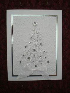 A white and silver Christmas card