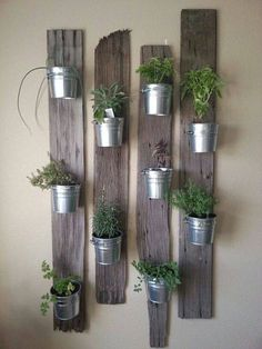 Vertical Gardens indoor herb garden idea: Tin Buckets on Re-Purposed Wood - In this post, we'll share 9 beautiful ways to bring your herb garden indoors, so that you can enjoy fresh herbs all year long. Vertical Garden Planters, Vertical Gardens, Planter Pots, Balcony Garden, Planter Ideas, Planter Garden, Wall Garden Indoor, Garden Walls, Indoor Wall Planters