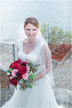 David's Bridal bride Shawnese in an A-line tulle wedding dress with floral lace details