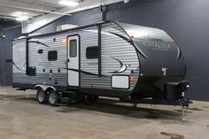 """SENSATIONAL TRAVEL TRAILER!!!  2017 Coachmen Catalina Legacy Edition 243RBS Unleash your inner adventurer in this 27' 11"""" long rig, weighing 5762 lbs! Go off-grid with solar panel prep or lounge in luxury with the 32"""" flat screen TV and multimedia sound system. On chilly nights, snuggle up on the 70"""" sofa and enjoy the heat radiating from your cozy fireplace! Give our Catalina Legacy Edition expert Corey Clarke a call 616-378-6784 for pricing and more information."""