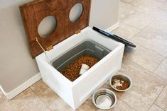 Keep your dog's food fresh and out of the way with this DIY dog food station with storage. The project includes free printable plans too! Read more: DIY Dog Food Station with Storage – Addicted 2 DIY Diy Wood Projects, Woodworking Projects, Woodworking Furniture, Woodworking Plans, Furniture Plans, Kids Furniture, Woodworking Tools, Furniture Design, Outdoor Furniture