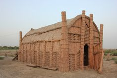 A Mudhif, a traditional reed house made by the Madan (marsh Arabs) people in the swamps of southern Iraq. Description from pinterest.com. I searched for this on bing.com/images