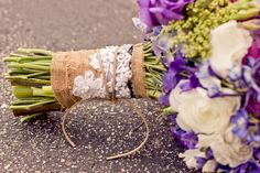 Art with Nature designed a pretty handtied bridal bouquet complete with a natural burlap and lace wrap Photo byHello Studios Bouquet by Art With Nature - Project Wedding