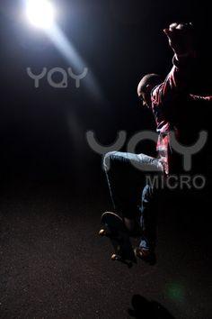 Skateboarder Jumping Under Dramatic Lighting